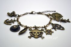 Anime One Piece charms bracelet, Steampunk Antique brass telescope anchor hat,boat rudder pirate fish bone and compass charm bracelet BHZ02