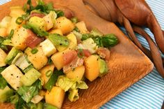 Honey Kiss Melon Chopped Salad recipe - includes honey kiss melon along with avocados, cucumber, mozzarella, prosciutto, scallions, basil, and romaine lettuce