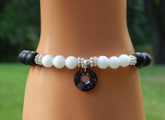 About the Bracelet Classic black and white - new unique look. The black swarovksi crystal is the highlight of this gorgeous black onyx and selenite gemstone bracelet. Bracelet Details: This gorgeous g