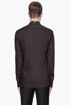 JOHN GALLIANO // BLACK AND WHITE ZODIAC SHIRT 31344M040005  Long sleeve shirt in black. Spread collar. Button closure at front. Graphic print throughout front panel in white and olive green. Shirttail hem. Single-button barrel cuffs with buttoned sleeve placket. 98% cotton, 2% elastane. Hand wash. Made in Italy. Zodiac Shirts, Man Shirt, John Galliano, Graphic Prints, Olive Green, Barrel, Long Sleeve Shirts, Cuffs, Italy