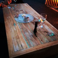 macrocarpa timber slab coffee table with glow in the dark resin