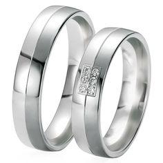 Le Duo Marly & Jolene brille par son élégance et son raffinement. En or noir et blanc, les diamants du modèle Marly apporte juste la touche nécessaire pour rendre l'alliance femme sophistiquée. http://www.zeina-alliances.com/alliance-duo/3511-duo-marly-jolene.html