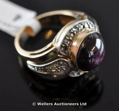 """""""Star ruby and diamond cluster ring, cabochon cut ruby to centre with a surround of rose cut diamonds, mounted in yellow metal, stamped 12ct gold """""""