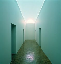 James Turrell, Lunette, 1974. Vertical portal cut to outside sky, interior filled with natural and warm white neon light, site-specific dimensions: portal cut: 91 x 200 cm (35 11/16 x 78 3/4 inches); hallway: 248.9 x 250 x 1483.4 cm (98 x 98 7/16 x 584 inches)