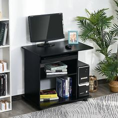 AMPLE STORAGE: This computer desk with shelves provides plenty of storage space and includes a pull out sliding keyboard, an adjustable middle shelf for books and accessories, a bottom shelf for legs, and side open shelf for CPU stand.|SPACE-SAVING DESIGN: this office desk measures 2.6' ft long, meaning it fits perfectly into the corners of small spaces while providing maximum space.|DURABLE CONSTRUCTION: A mix of steel and natural grade MDF creates a sturdy working or writing home…