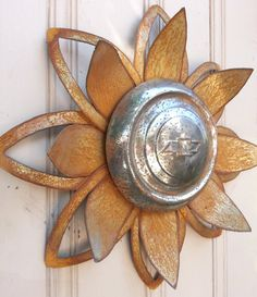 Rusted metal lotus flower wall hanger with Chevy hubcap yard art by MyRustedRoots
