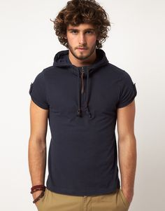 Short sleeve hoodie tshirt...zipper down, cleavage out? :-) or maybe a khaki camisole under?