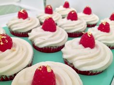 Raspberry, white chocolate and madagascan vanilla cupcakes...with a little gold leaf garnish. Fancy!