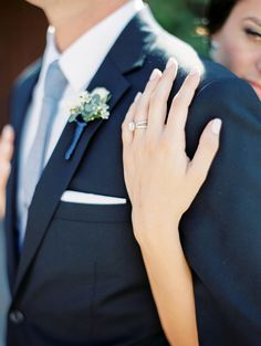 brides hand with solitaire engagement ring with halo on grooms chest http://itgirlweddings.com/pretty-scottsdale-wedding/