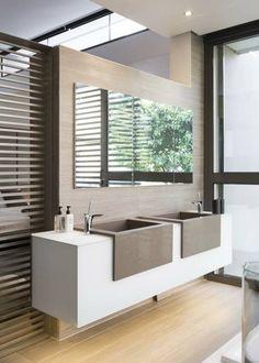 Baños de estilo translation missing: mx.style.baños.moderno por Meulen Architects