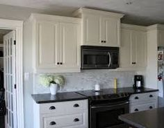 Image result for white cabinets black countertops