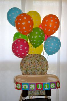 Birthday high chair....I like the balloons behind the chair and the name in front