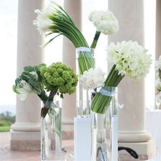 Modern arrangements of calla lilies, hydrangeas, amaryllis, green viburnum and ornamental cabbage greeted guests as they entered the ceremony space.  from the album: A Vivid Modern Wedding in Newport Beach, CA