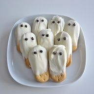 White Chocolate Ghost Cookies. How cute for a Halloween Party. Dip Vienna fingers or Nutter Butters in White Chocolate and make eyes with chocolate chips.