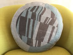 Hand screen printed round box cushion with 'Tectonic' design. on stonewashed grey cotton