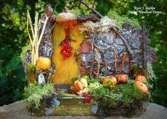 One of a kind magical pumpkin tender Fairy Door.  Oak bark, reindeer moss, miniature mushrooms and real crystals.  Perfect for the autumn fairies of October.  Created by Roxie Zwicker, Spirited Woodland Designs.
