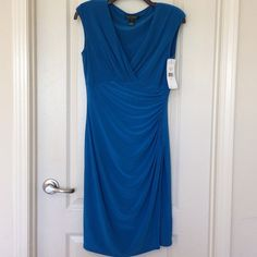 🎉 HOST PICK 🎉 Ralph Lauren Wrap Dress Wrap dress. NWT. If you don't like the price, don't hesitate to make me an offer. Ralph Lauren Dresses