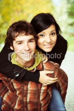 Young adult brother and sister piggybacking. Royalty Free Stock Photo