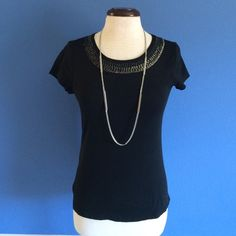 """New ListingBlack Shirt w/Sequined Neckline This black shirt has pop with the sequined neckline (which continues to the back for the shirt).  Perfect for work or any occasion. Dress up with pants and blazer or dress down with jeans.  Material:  60% Cotton/49% Modal; Measurements: Length - 23.5""""/Bust - 17"""" Ann Taylor Tops"""