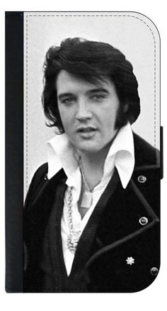 Elvis Presley Close Up © PU Leather Apple iPhone 6 Plus, 6s Plus Wallet Case. Quality Leather-Look Wallet Case with Flip Cover and Magnetic Clasp Compatible with the Apple iPhone 6 Plus/6+/6s Plus/6s+ (NOT COMPATIBLE WITH THE STANDARD IPHONE 6 OR 6S). Bright, Eye-Catching Flat-Printed Image on Metal Substrate with Glossy Finish. Made and Manufactured in the U.S.A. Excellent Customer Service! Great Gift Idea!. As the sole manufacturer of this Item, Lea Elliot Inc. does not take…