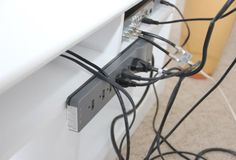 Hide wire clutter using an affordable plastic shower rod cover avail. at hardware or home improvement stores. Easy and affordable solution to messy wires! Hide Tv Wires, Hide Tv Cables, Tv Cords, Hiding Wires, Hidden Tv, Hidden Rooms, Cacher Cable Tv, Diy Rangement, Shower Rod