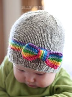 Knit your little one a sweet RainBOW baby hat including rainbow band and bow with this adorable knitting pattern!