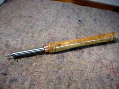Woodturning Ornament Rotative Tool by Christophe Mineau - Here is my rotative tool for making some nice ornaments in woodturned pieces :Its done using a pair of micro ball bearings, 3.2 mm interior diameter, inserted with a spacer in the tip of a 10 mm shaft, itself inserted in a woodturning tool handle.The handle is made out of figured ash.So the bits are standard Dremel bits, I have different shapes, cylinder, ball, or conical as on the picture.It's applied with a litt