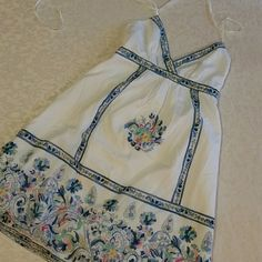 American Eagle Outfitters Sundress NWOT Pretty white cotton halter dress with boho vibe. Pretty pattern of soft blue, pink, mint, and yellow. Fully lined 100% cotton. American Eagle Outfitters Dresses