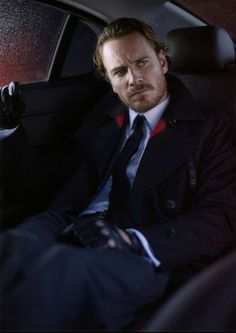 Michael Fassbender looking like someone has pissed him off.  They were probably making fun of his gloves.
