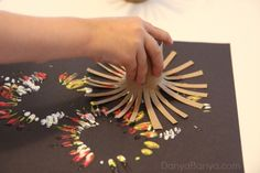 Fireworks painting using DIY toilet paper roll stampers