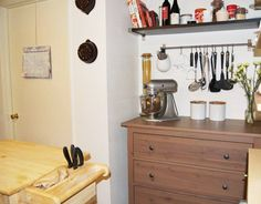 shelving, island, utensil rack, and cabinet from Ikea