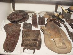 Here are a few of our old Holsters and other Cowboy items that are in our Cowboy Display case.