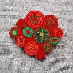 Red felt brooch  by Elin Thomas