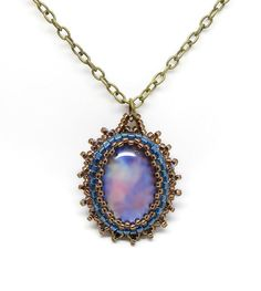 An Exotic Bronze And Blue Pendant Necklace, £14.00 by Tricia Cole Jewellery:   This unique pendant/necklace features a very pretty glass cabochon which is enclosed within a handmade bezel of complimentary colours. The bronze plated chain measures 18\\\