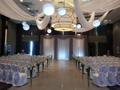 Westney Room Ceremony set for 110 with Ceiling Swag and Lantern Ceiling Treatments and Vases Lining the Aisle