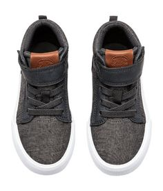 Dark gray melange. High tops in chambray and faux leather with a padded edge, hook-loop fastener, and elasticized lacing. Mesh lining and insoles. Rubber