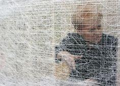 Almyra Weigel. Sewing threads on the newspaper. Detail.  www.almyraweigel.de