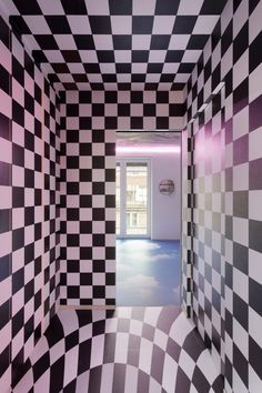 A series of lengthy corridors lead to Defhouse's sleeping quarters – some of the corridors feature an all-over chequerboard print, while others have walls inscribed with glow-in-the-dark writing. Monochrome Interior, Interior Design, Polka Dot Rug, White Storage Cabinets, Neon Artwork, Built In Furniture, Milanesa, Shared Rooms, Concept Home