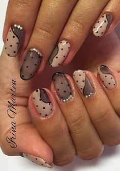 Nude and black nails with polka dots