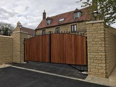 The Dorchester. Iroko wooden cladded with feature header. Electric Driveway Gates, Electric Gates, Wooden Gate Designs, Wooden Gates, Dorchester Collection, The Dorchester, Bow Tops, Fences, Wood And Metal