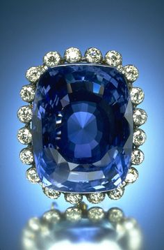 The magnificent 423-carat Logan Sapphire was cut from a crystal mined in Sri Lanka and is one of the world's largest faceted blue sapphires (it is about the size of an egg). It is the heaviest mounted gem in the National Gem Collection, and in its silver and gold brooch setting is framed by twenty round brilliant-cut diamonds, totaling approximately 16 carats.