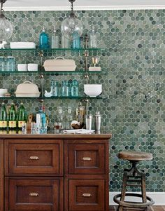 Fully tiled kitchen wall with top shelves and bottom cabinets