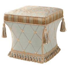 """Latticework-detailed ottoman with a paisley-print top and braided trim. Includes tasseled fringe and accents.  Product: OttomanConstruction Material: Polyester and woodColor: MultiFeatures: Cord, braid, tassel trim and tasselsDimensions: 18"""" H x 16.5"""" W x 16.5"""" DNote: Assembly required"""