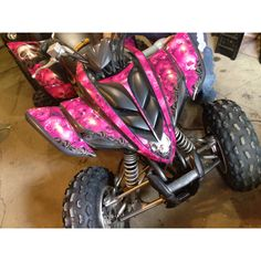 Pink quad decals on a 2005 Yamaha raptor  Decals from amr racing