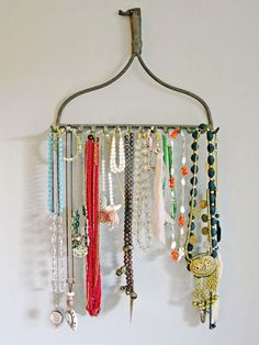 Old rake cut off and used to hang necklaces and bracelets.  More DIY jewelry storage ideas - http://thegardeningcook.com/jewelry-displays/