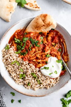 Slow Cooker Chicken Tikka Masala is a lightened up comforting Indian dish made with tomato sauce, chicken breast, coconut milk and flavorful, bold spices like garam masala, ginger, cayenne, curry powder and so much more. Serve with brown rice or naan for a full meal! #tikkamasala #indianfood #slowcooker #slowcookerecipe