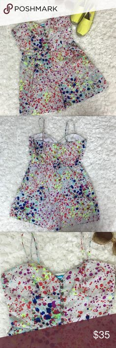 """Lamour Nanette Lepore Ink Splatter Romper Ink splatter print romper by Lamour Nanette Lepore. Side concealed zipper sweetheart neckline with buttons down the center. Adjustable spaghetti straps. Side seam pockets. Size read large but please check measurements. Length measures 25"""" down from bottom of strap to hem. 17"""" bust and 2.5"""" inseam. 100% polyester. Nanette Lepore Pants Jumpsuits & Rompers"""