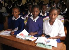 Girls in Africa reading the puberty books, which include information on menstrual management, that Marni Sommer developed with