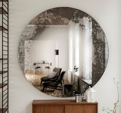 Pink decorative mirror. Round, antiqued wall mirror made from Art Deco inspired…