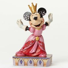 """Minnie Mouse gets the royal treatment we all deserve in this colorful new design from artist Jim Shore. Dressed to the nines and wearing a crown, she's a happy reminder of how good it feels to be """"Que"""